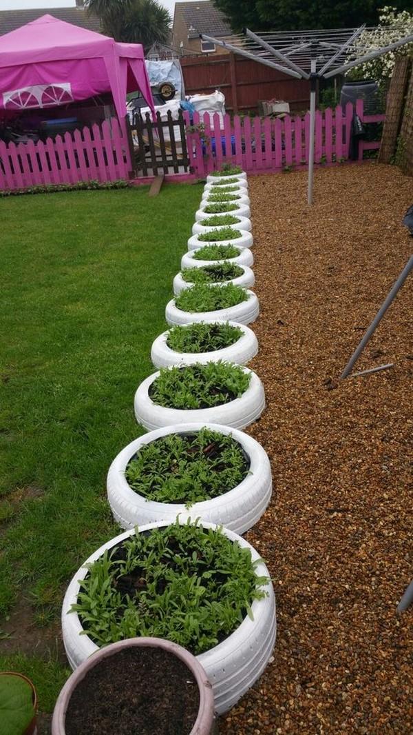 15 hermosas ideas para decorar macetas de neum ticos viejos - Jardineras con ruedas ...